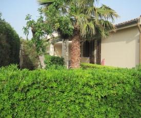 Casa vacanza con giardino in residence